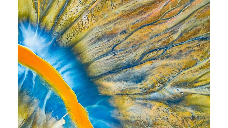 Romanian photographer Gheorghe Popa took this shot of a small river in the Apuseni Mountains which has taken on these vivid colors due to toxic waste from a nearby mine.