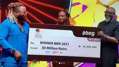 PHOTO: BBNaija organisers present Whitemoney with N30m cheque, SUV, two-bedroom apartment key