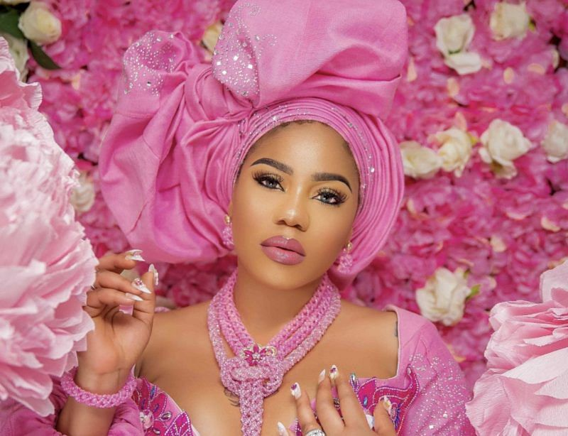 Toyin Lawani displays baby bump, asks fans to name unborn child