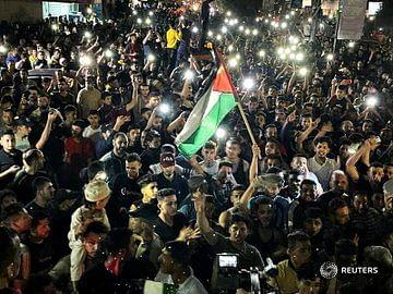 PHOTOS: Celebration as Israel, Hamas embrace ceasefire