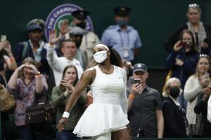 Tennis – Wimbledon – All England Lawn Tennis and Croquet Club, London, Britain – June 29, 2021 Serena Williams of the U.S. leaves court as she retires from her first round match against Belarus' Aliaksandra Sasnovich after sustaining an injury REUTERS/Peter Nicholls