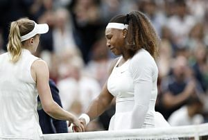 Tennis – Wimbledon – All England Lawn Tennis and Croquet Club, London, Britain – June 29, 2021 Serena Williams of the U.S. shakes hands with Belarus' Aliaksandra Sasnovich as she retires from their first round match after sustaining an injury REUTERS/Peter Nicholls