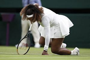 Tennis – Wimbledon – All England Lawn Tennis and Croquet Club, London, Britain – June 29, 2021 Serena Williams of the U.S. reacts after sustaining an injury during her first round match against Belarus' Aliaksandra Sasnovich REUTERS/Peter Nicholls
