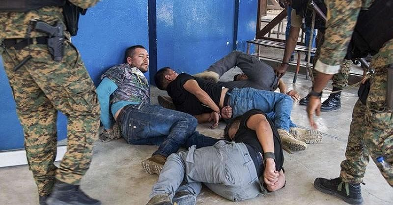 Photos: Haiti arrests two Americans, 26 other suspects over President Moise's assassination