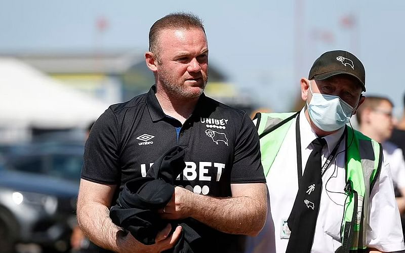 Wayne Rooney invites police as pictures of him with half-naked women go viral