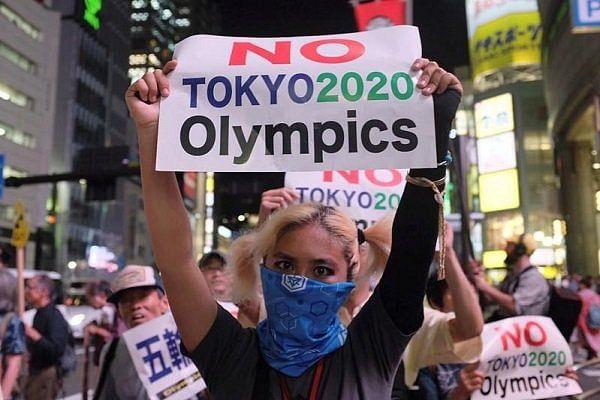 PHOTOS: Protests in Tokyo as games begin
