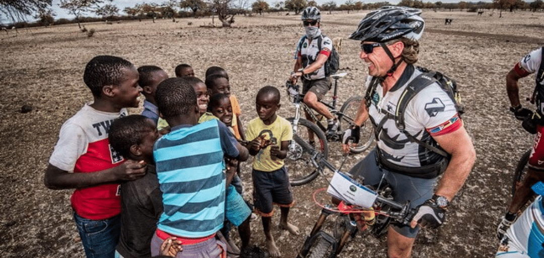 Nedbank Tour de Tuli  rider engages with kids n the route